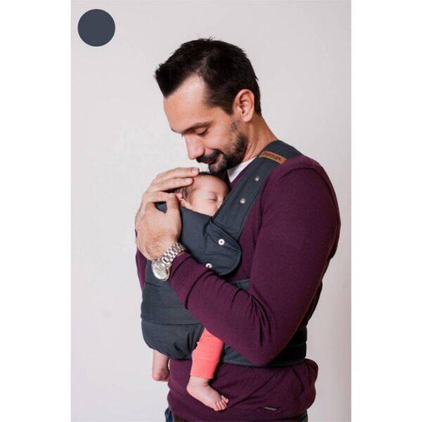 Stock image of man carrying small baby in dark grey marsupi